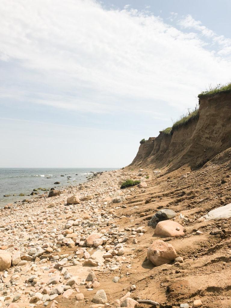 A rocky cliffside beach in Montauk, a popular road trip destination