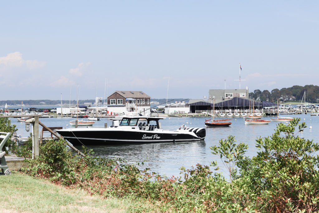 A small harbor with boats in Greenport, NY- a popular road trip destination