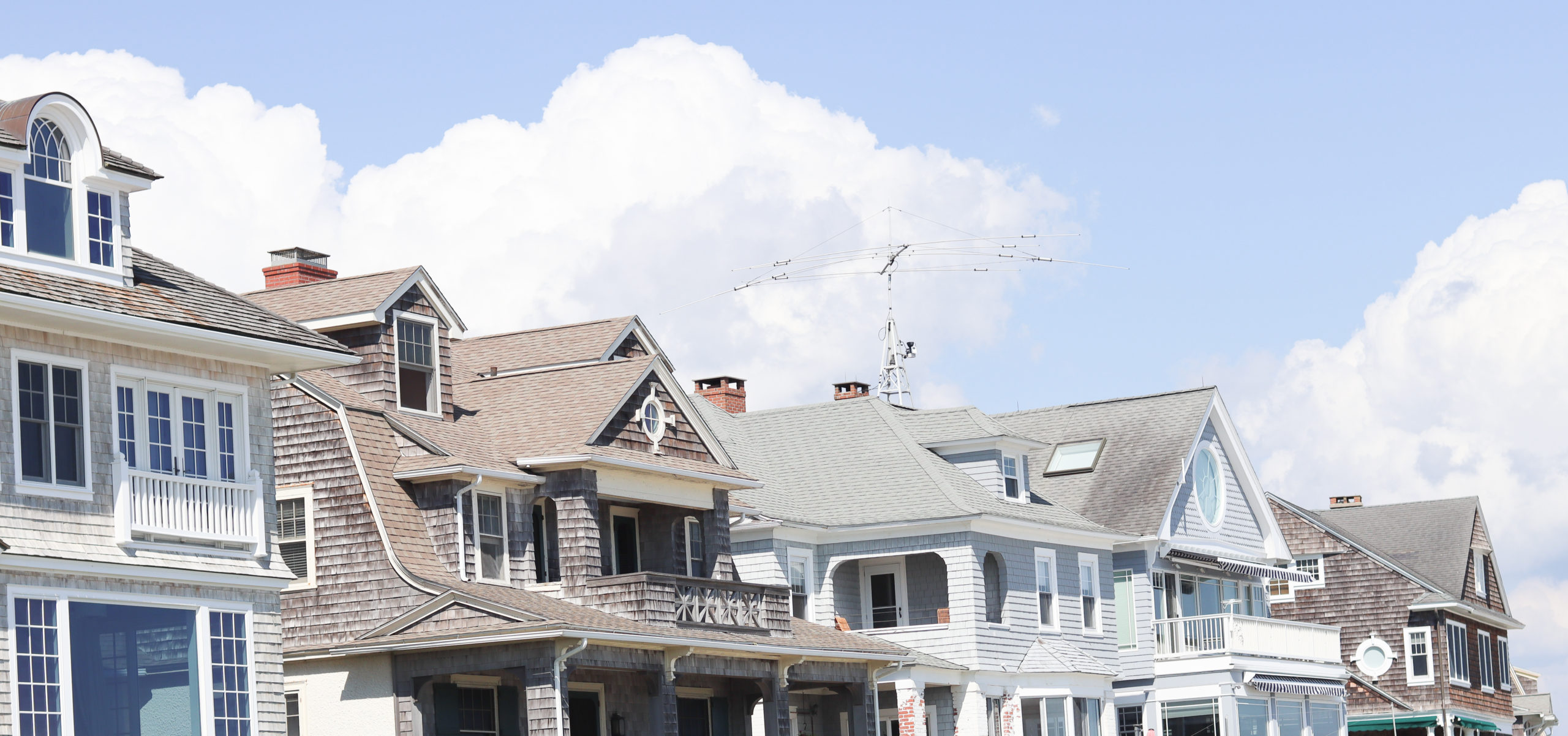 A row of pastel beach houses in Mystic, a popular summer road trip destination