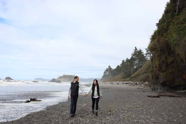 Couple holding hands at Ruby beach