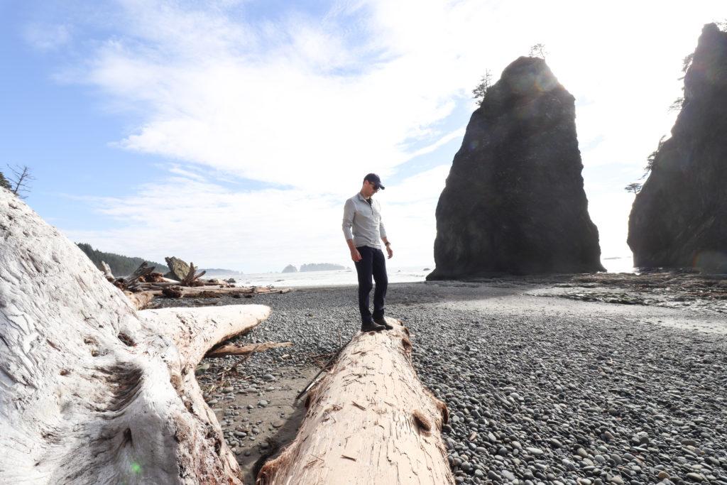 Man standing on driftwood lot on ONP beaches