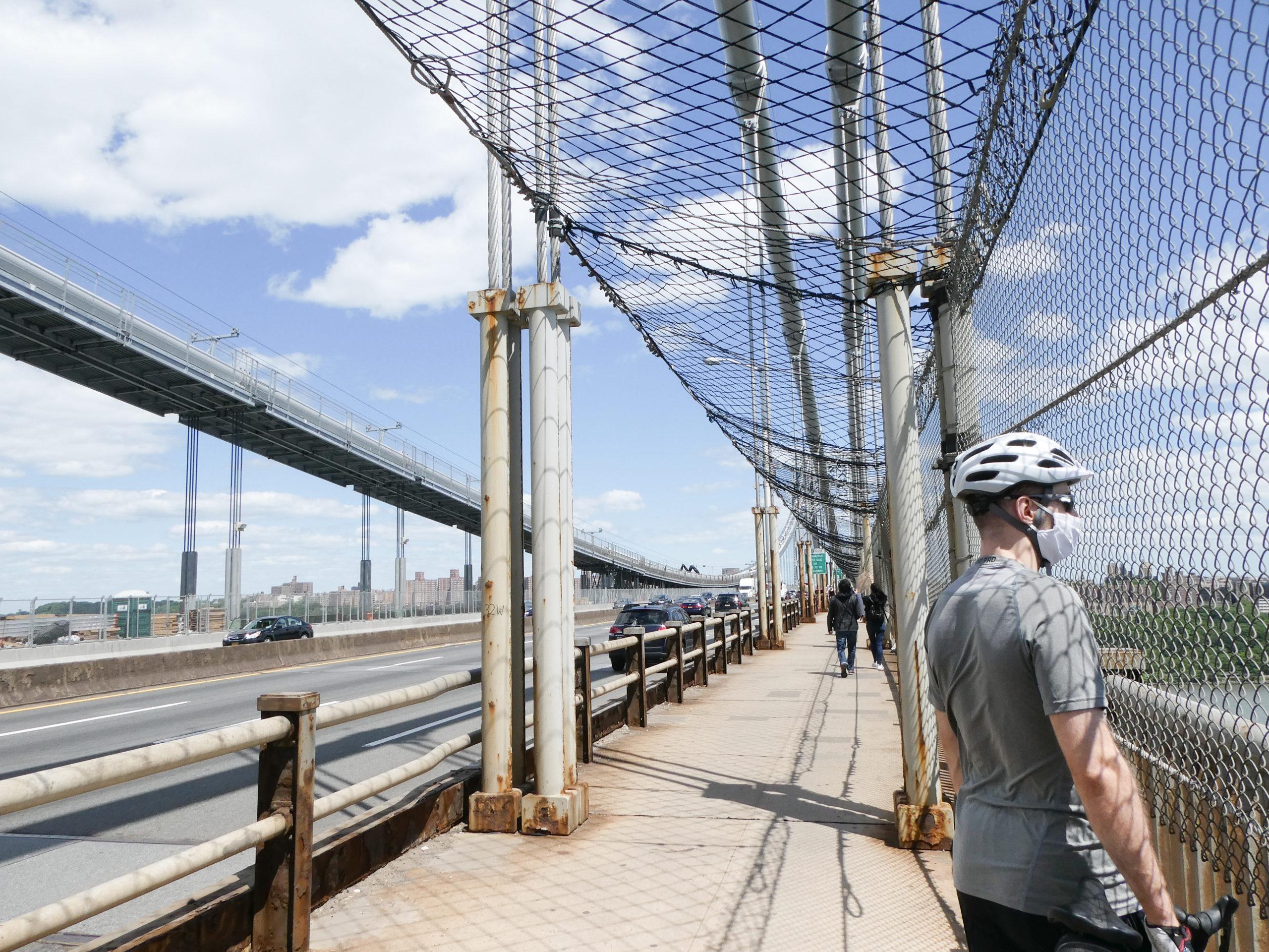 A man standing on the George Washington Bridge