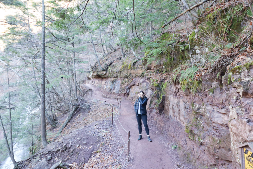 Woman standing on a trail on Kaaterskill Falls hike