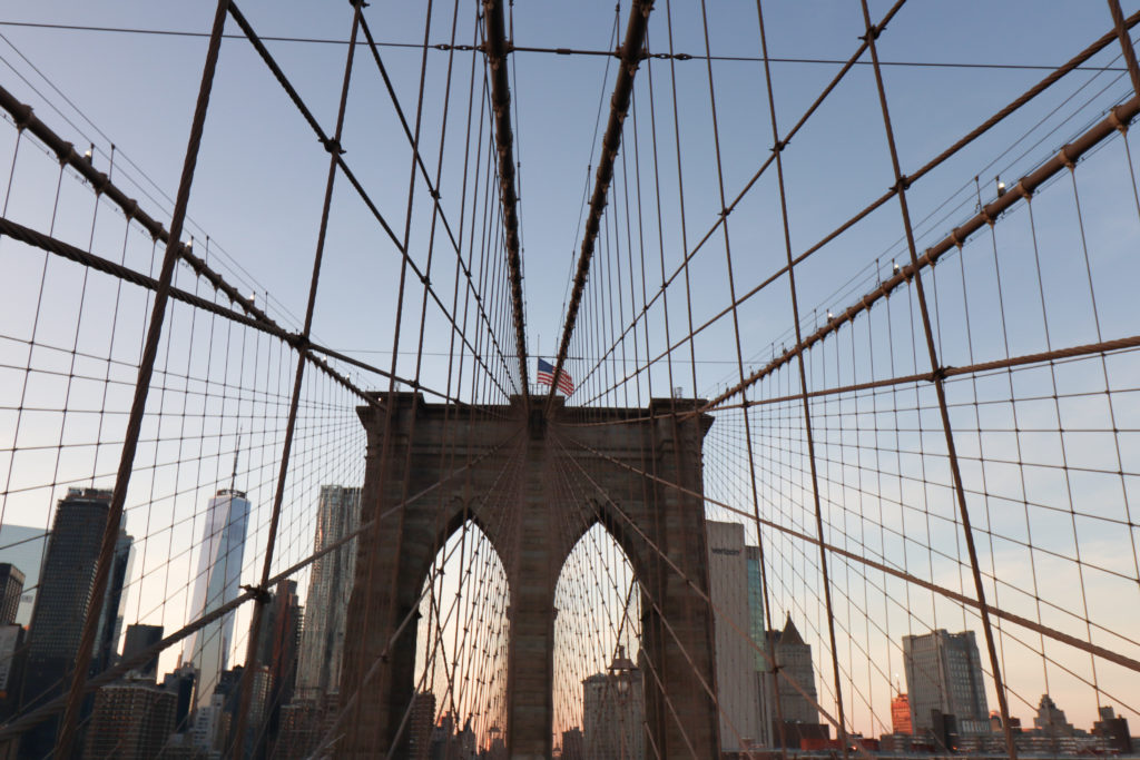Brooklyn Bridge with the Manhattan skyline in the background.