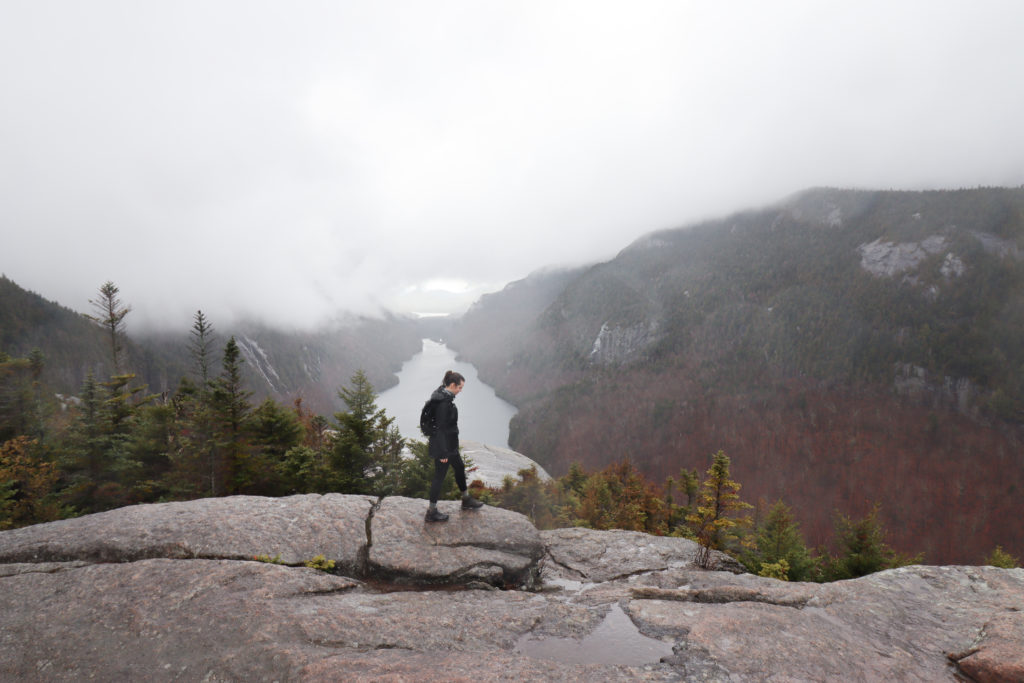 Woman standing at the summit of Indian Head Trail