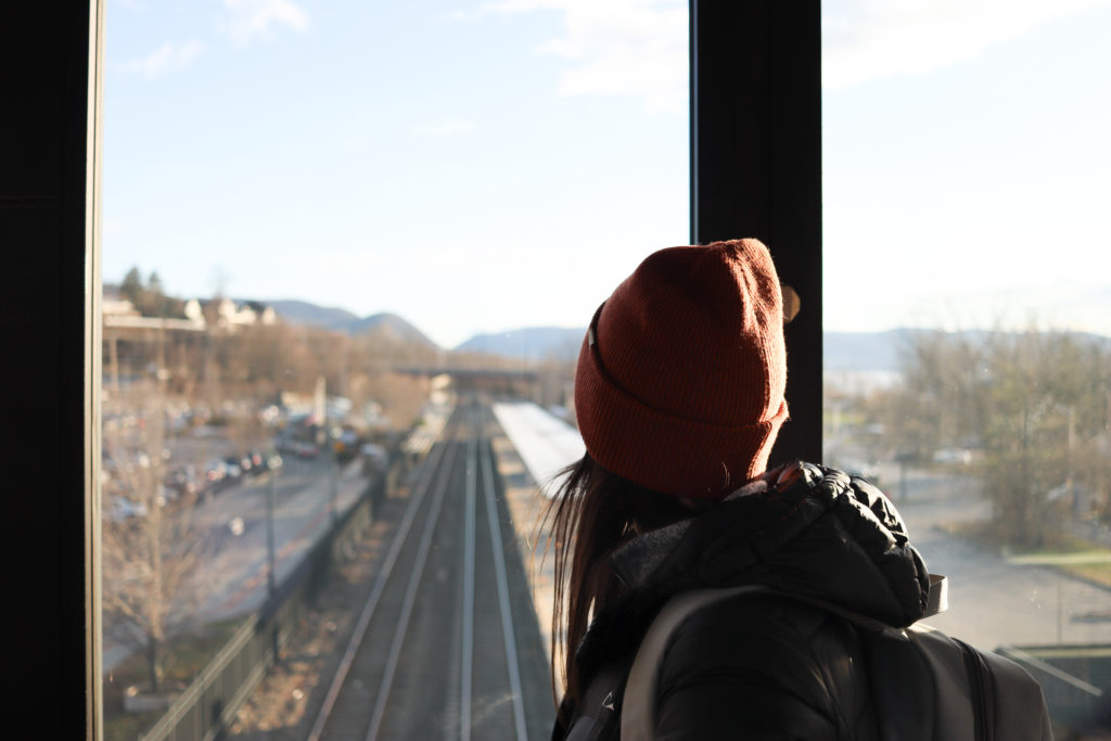 A women looking at the Hudson, NY train platform after a weekend road trip.