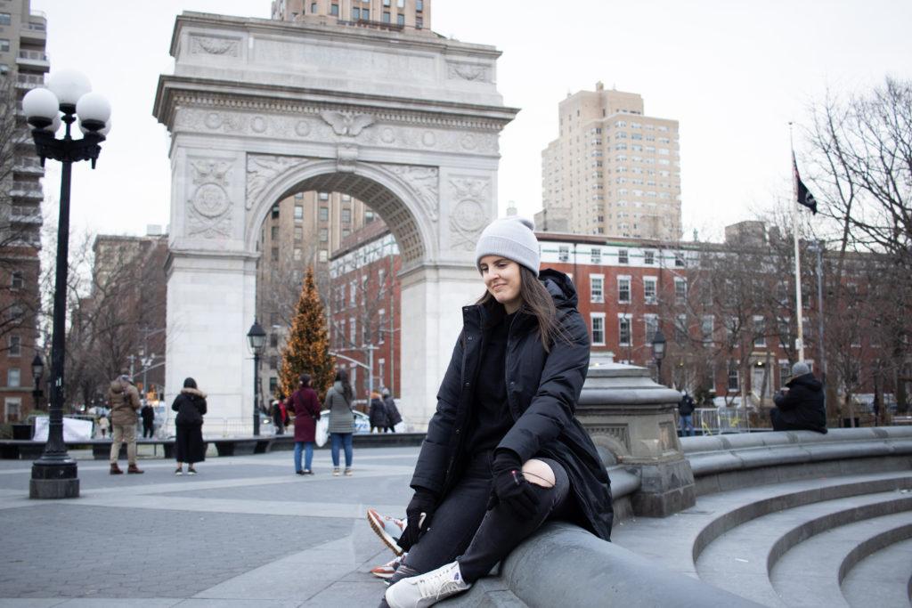 Women taking Instagram photos in Washington Square Park