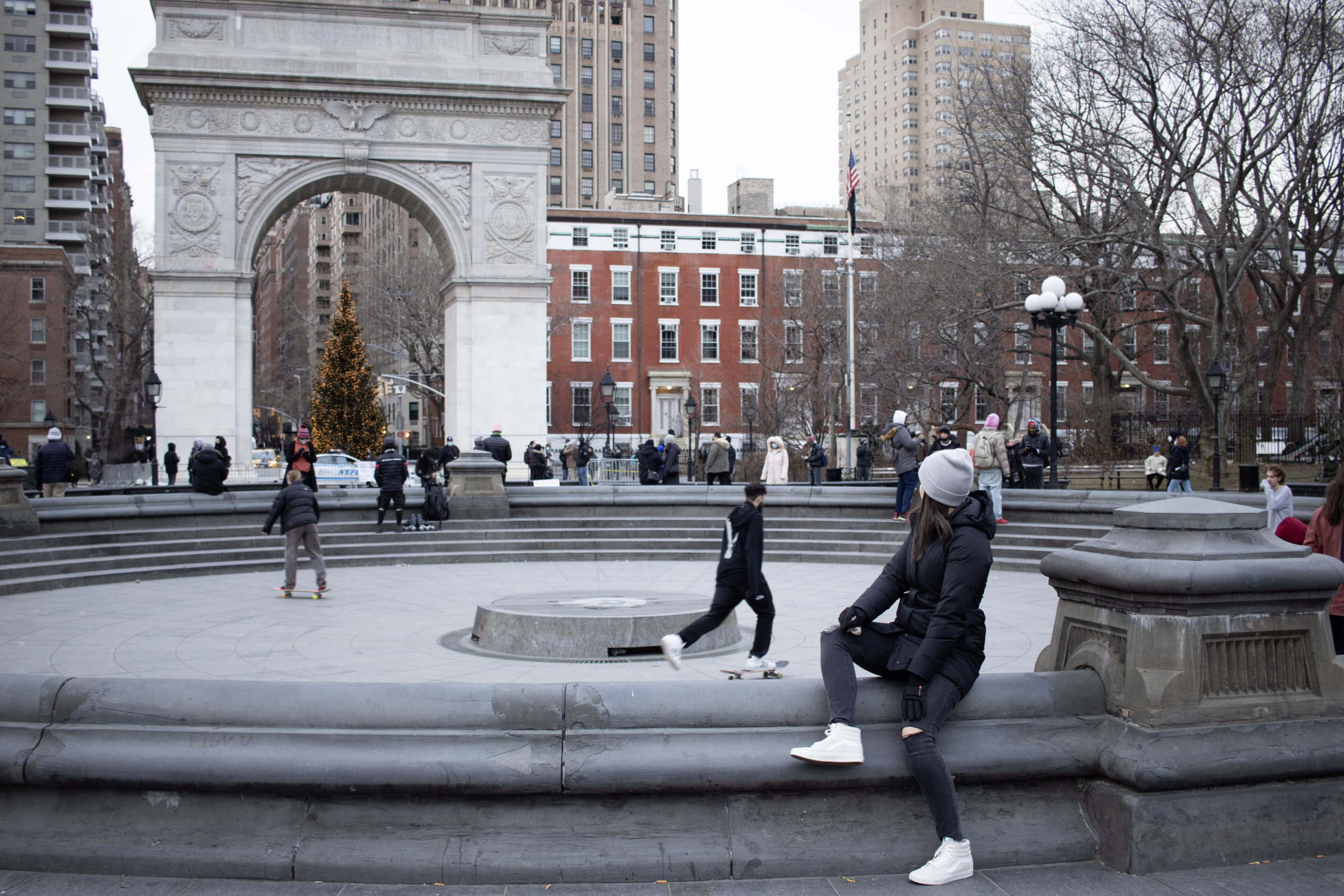 Women looking back on Washington Square Park, one of the Instagram spots in NYC