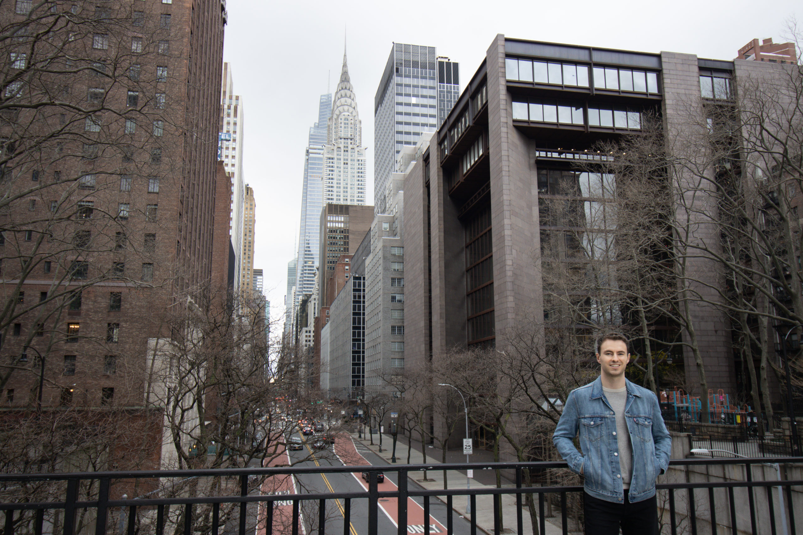 Man standing on Tudor overpass, once of the Instagram spots in NYC