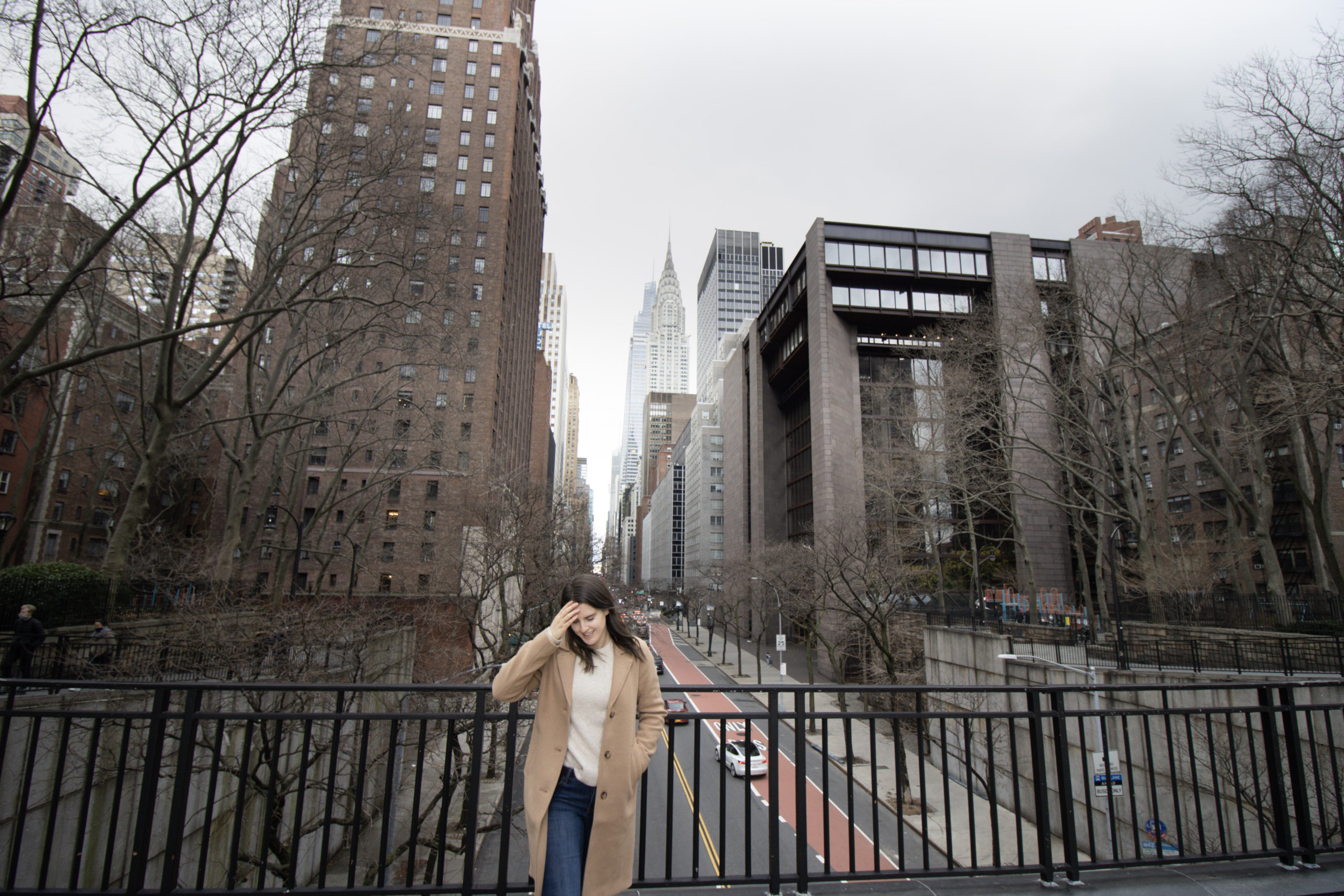 Woman standing on Tudor overpass, one of the Instagram spots in NYC
