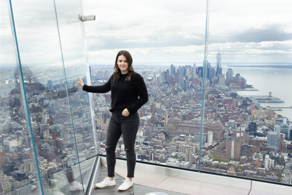 Woman posing on The Edge for Instagram photos