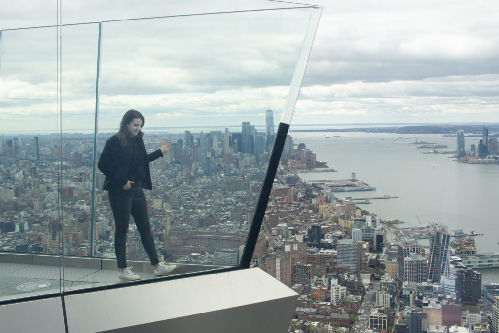 Woman posing on The Edge, one of the Instagram spots in NYC