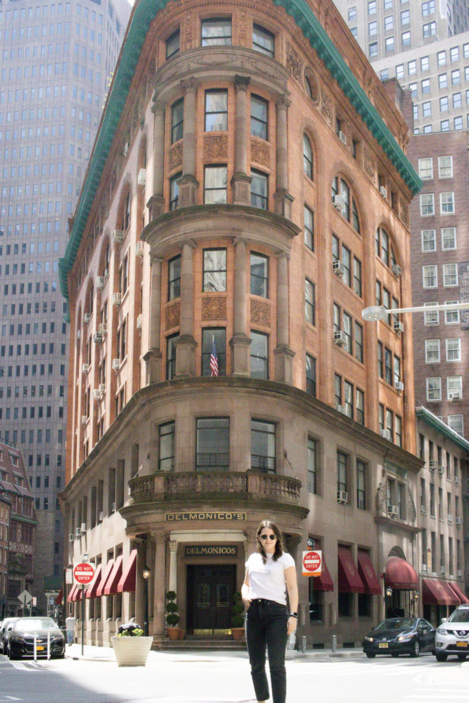 Woman standing in front of Delmonico's in NYC