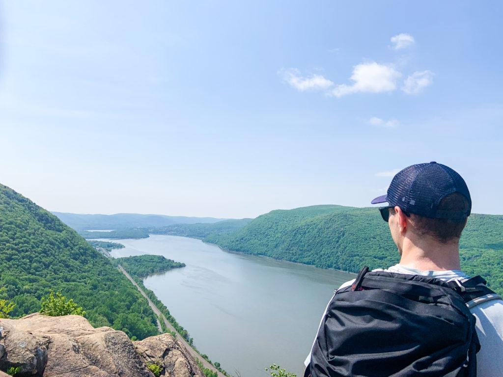 Man standing at summit of Breakneck Ridge trail