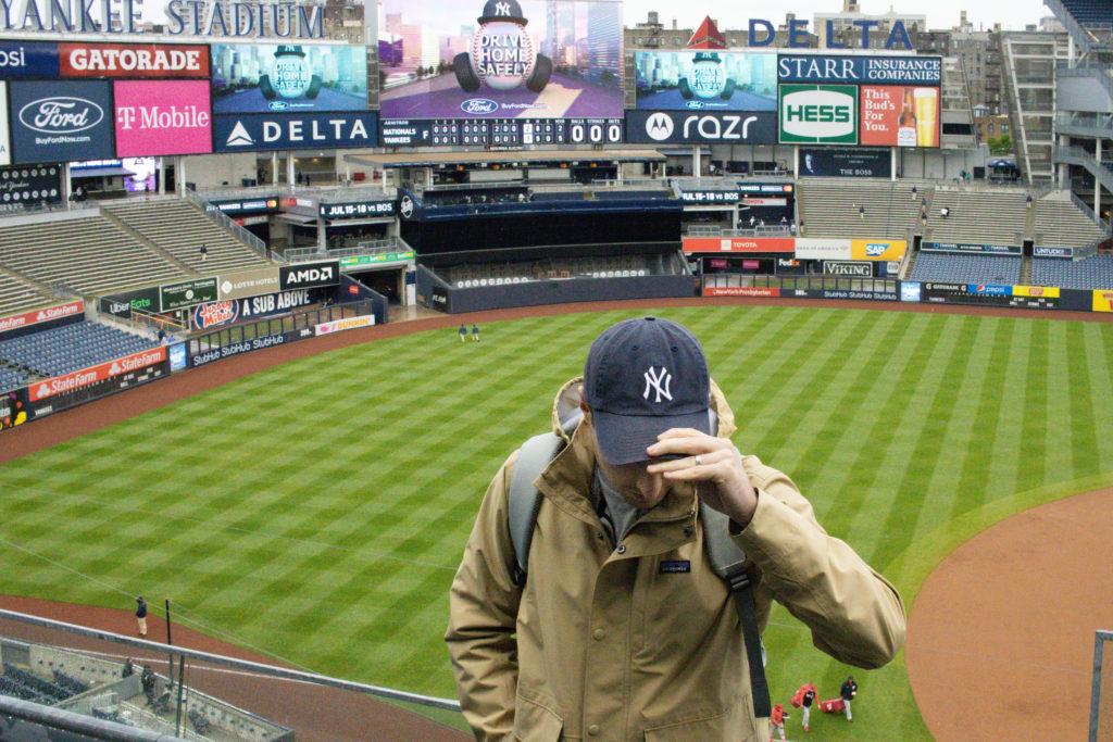 Man standing in yankee's stadium