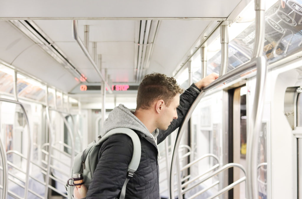 Man standing on NYC subway