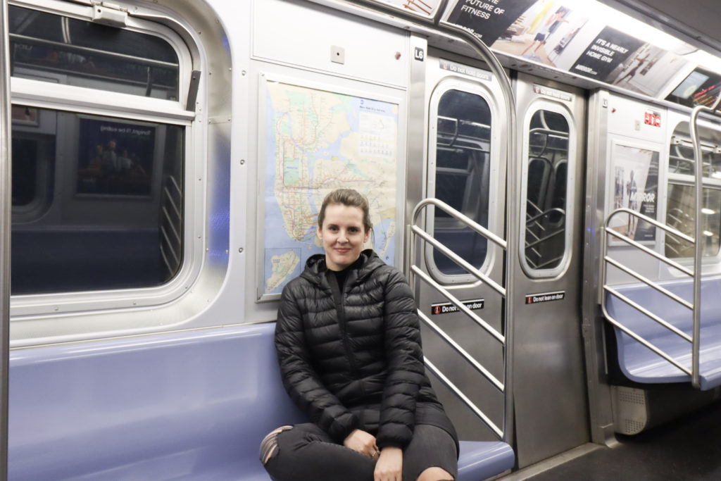 Women getting instagram photo on NYC Subway