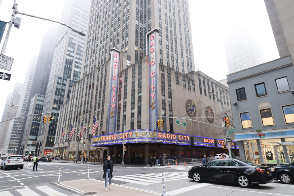 Women getting Instagram photo in front of Radio City Music Hall