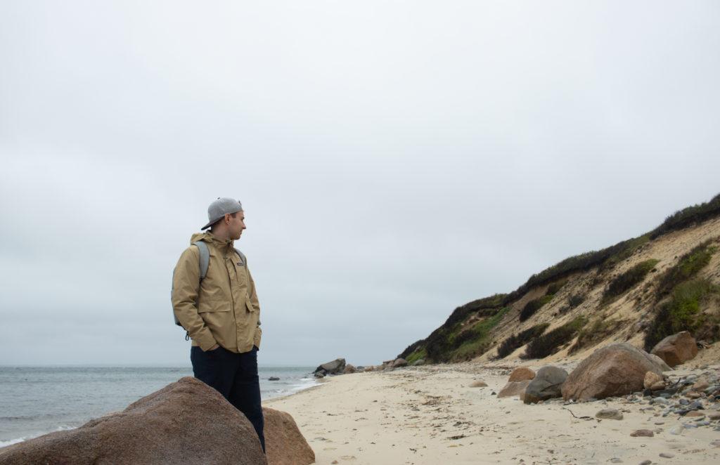 Man standing on beach on one of the Martha's Vineyard beaches