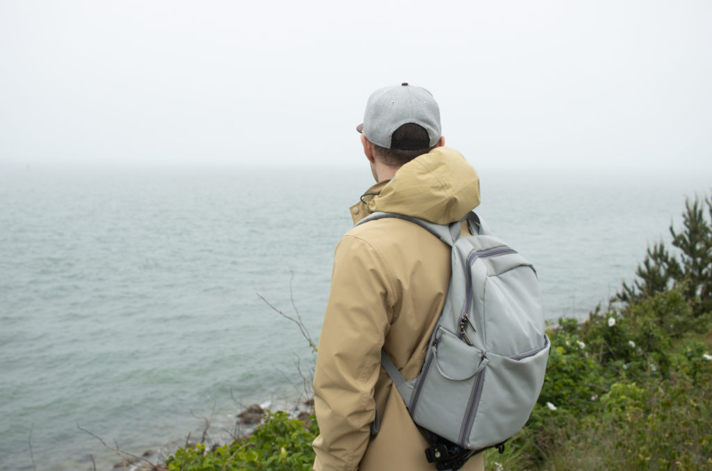 Man looking out into the ocean on Martha's Vineyard