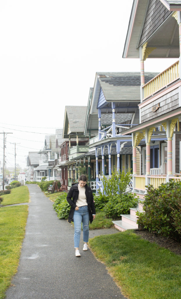 Woman standing in front of colorful house in Oak Bluffs, Martha's Vineyard